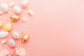 Easter Flat Lay of Eggs with flowers on pink