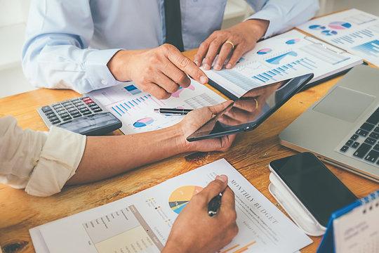 Business advisor analyzing financial figures denoting the progress Internal Revenue Service checking document. Audit concept