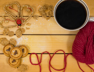 Cup and cookies on wooden background.
