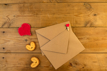 An envelope on wooden background.