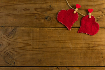 Red hearts on wooden background.