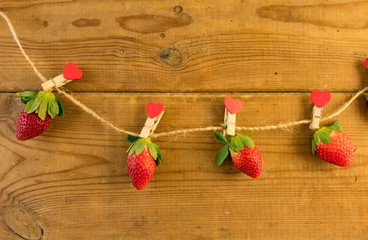 Strawberry hanging on a rope.