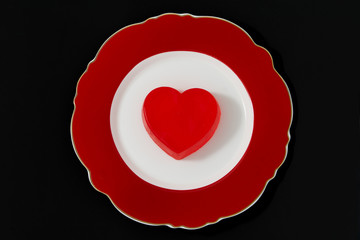Red heart on a red plate.