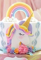 Details  of a unicorn cake  -  Unicorn topper close up