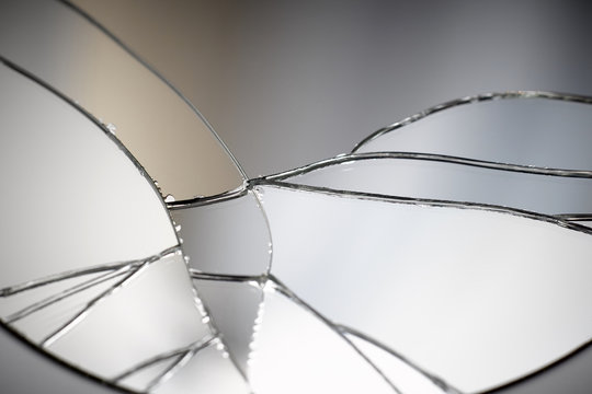 Crack and broken mirror in a front view image.
