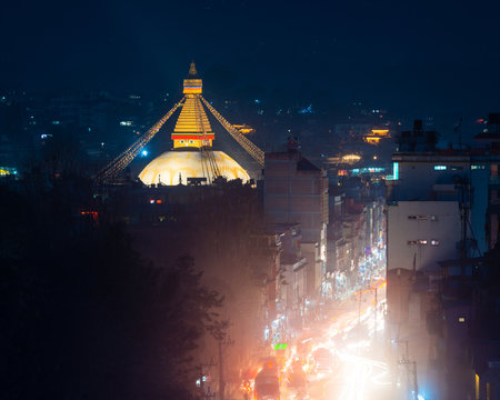 Boudhanath stupa and Boudha Road at night in Nepal.