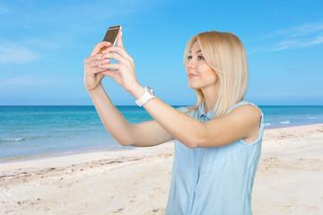 teenage girl making selfie photo with smart phone