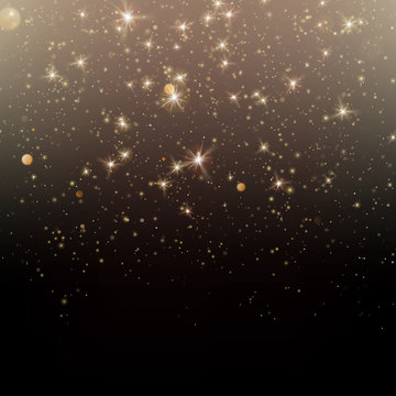 Particles glitter of gold glowing magic shine and star dust dark background. EPS 10