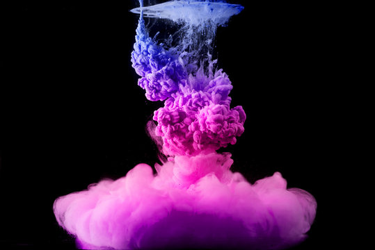 colored acrylic paint in water. the explosion of colours on a black background