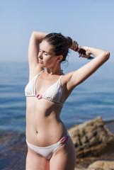 Girl on rocky beach