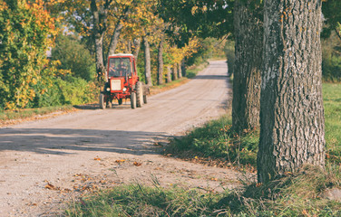 Tractor driving on a rural road