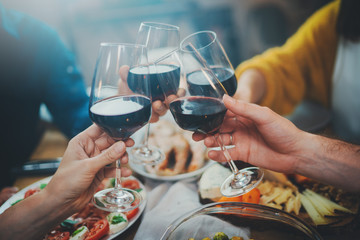 Close up image of best friends making cheers with wine glasses during birthday party at restaurant, happy family celebrating anniversary at home, Friendship Dinner Holidays Concept
