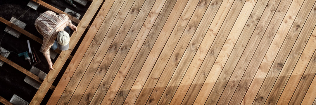 Constructing the wooden flooring of a patio