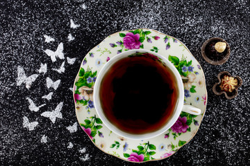 top view of  tea in porcelain cup on on slate tray