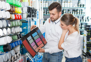 pair choosing color for painting
