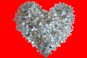 Thai Baht lots coin Arranged in heart shape on with red background texture, Investment and saving concept, Money stack for business planning investment, A lot of money.