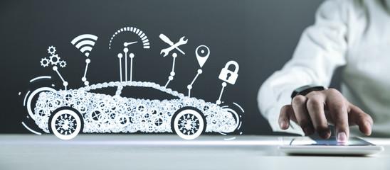 Man holding digital tablet. Modern smart car. Transportation, Technology Concept Wall mural