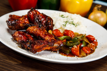 Roasted chicken wings white rice and vegetables