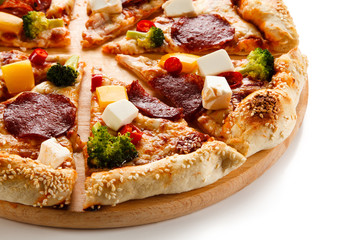 Pizza with salmi and feta cheese and vegetables on white background