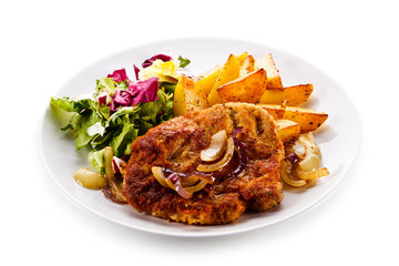 Fried pork chop with potatoes on white background