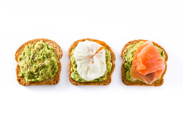 Toasted breads with avocado, poached eggs and salmon isolated on white background. Top view.