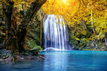 Wall Mural - Erawan waterfall in autumn, Thailand. Beautiful waterfall with emerald pool in nature.