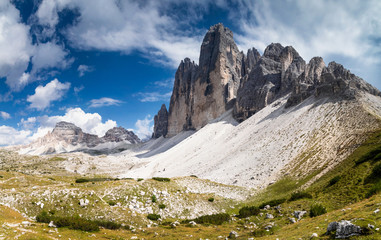Summer view of Tre Cime di Lavaredo with rocky foreground in the Dolomites, South Tyrol, Italy