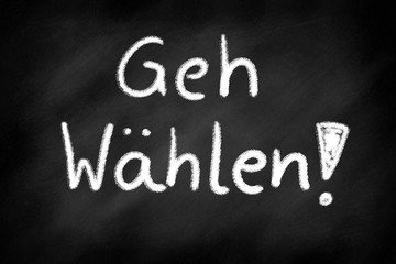 Go voting, german lettering on a blackboard