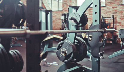 Barbells close up at gym. Sports equipment in gym, interior