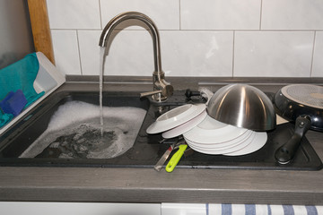 The clogged sink.