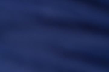 soft blurred mysterious dark blue fabric texture background