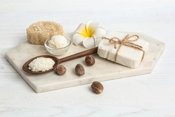 Composition with Shea butter and nuts on table