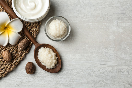 Flat lay composition with Shea butter, nuts and space for text on light background