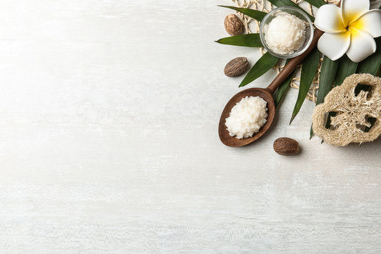 Flat lay composition with Shea butter and nuts on light background. Space for text