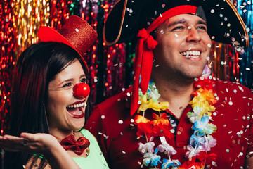 Couple in costume celebrating the carnival party in Brazil