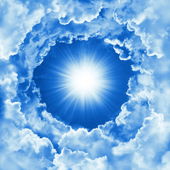 Sky with beautiful cloud and sunshine. Religion concept heavenly sky background. Sunny day, divine shining heaven, light. Peaceful nature background