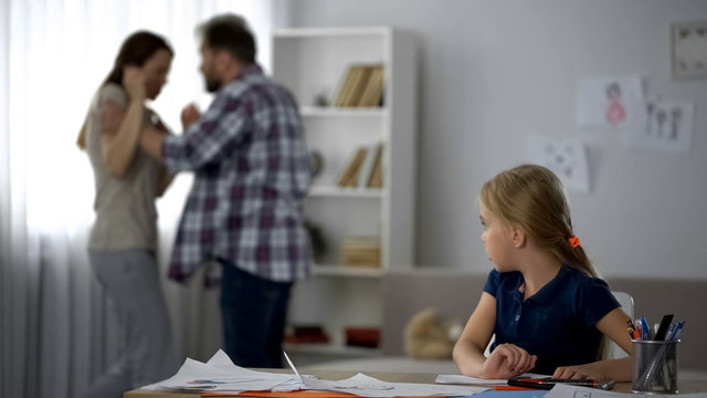 Parents fighting at home, child growing in conflicts and aggression, divorce