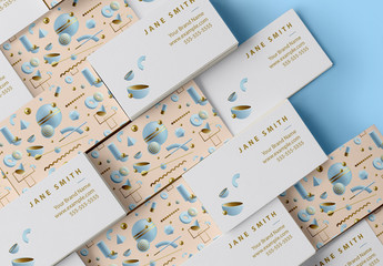 Pastel Business Card Layout with Abstract 3D Patterns