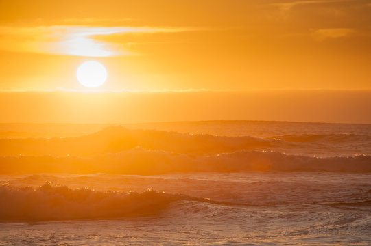 Sunset with waves at Oceanside Beach in Oregon