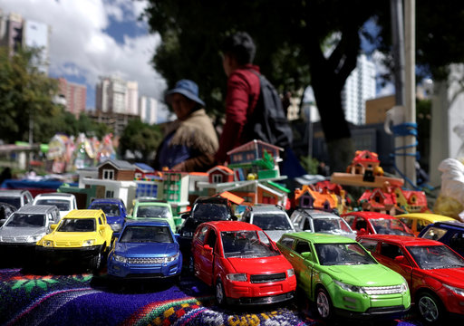 "Miniature cars and houses are seen at the ""Alasitas"" fair, where Bolivians buy miniature versions of goods they would like to own with the hope of acquiring them in real life during the year, La Paz"