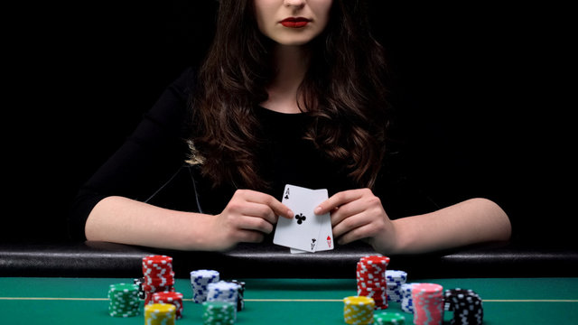 Attractive woman showing aces pair at casino poker game, feminine trick, luck