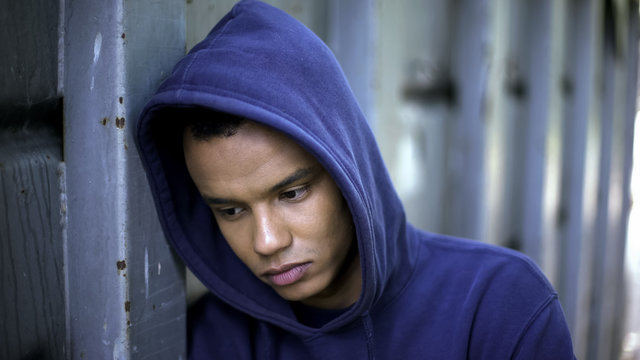 Mixed-race guy suffering from bullying, racial discrimination, cruel youth