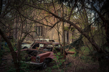 Destroyed and abanoded car in an abandoned place
