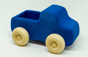blue toy car or truck on white background