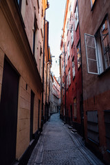 Diminishing perspective of empty alley amidst buildings in city