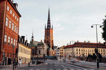 Street by Riddarholm Church against sky in city Fotomurales