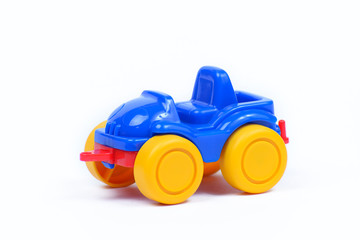 Toy plastic car on a white background