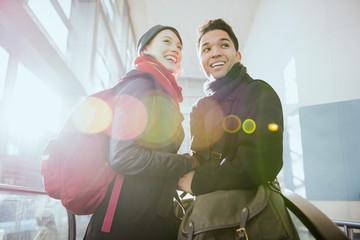 Smiling Couple On Escalator