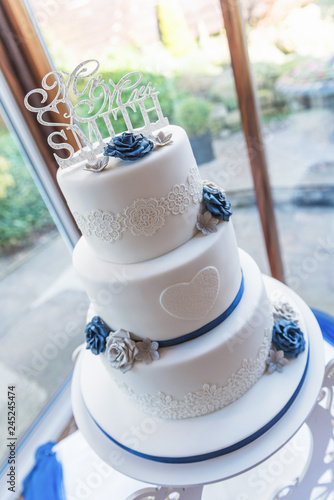 3 Tier Wedding Cake With Blue Ribbon Stock Photo And Royalty Free