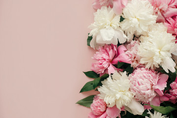 Foto auf Leinwand Blumen Stylish peonies flat lay. Pink and white peonies on pastel pink paper with space for text. Hello spring. Happy mothers day, floral greeting card mockup. International Womens Day.